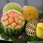 Fruit and vegetable Carving arrangement. The bird is carved from acorn squash with a crookneck squash neck and head and carrot beak.