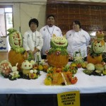 4th Place winning team from Columbus Culinary Institute with their vegetable sculpture that had an Alice in Wonderland Theme.