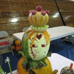 4th Place winning team with their vegetable sculpture that had an Alice in Wonderland Theme.