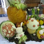 Details of 4th Place winning team with their vegetable sculpture that had an Alice in Wonderland Theme.