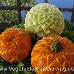 Carved honeydew melon and pumpkins carved with flower designs