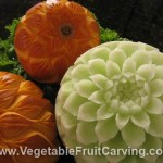 Thanksgiving Centerpiece with carved honeydew melon and pumpkins carved with flower designs