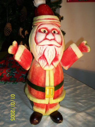 Santa carved from watermelon - fruit carving for Christmas