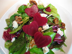 salad with goat cheese with sliced beets cut into the shape of hearts ...