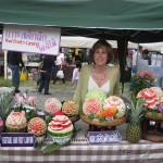 Nita at Songkran Festival with Thai style fruit carvings