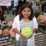 Kimberly with her carved honeydew.