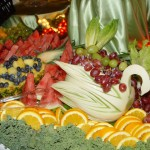 Wedding fruit display with carved fruits, carved honeydew swan