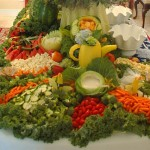 Wedding fruit display with cabbage dip bowl, squash pitcher, carved watermelon, honeydew swan and bride and groom yellow squash birds.