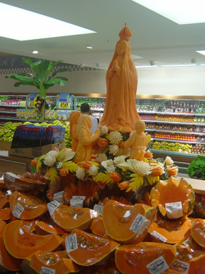 Pumpkin carvings depicting Lady of Famita scene