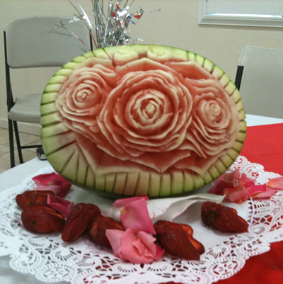 carved rose in Watermelon by Mike Gahli