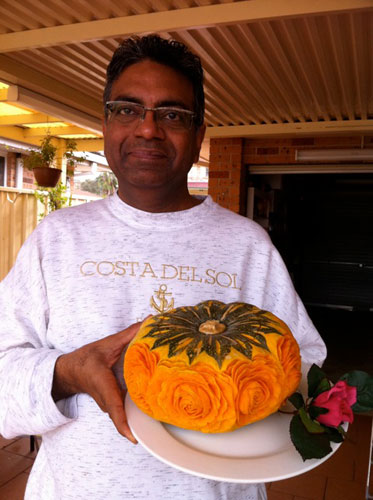 Tahir Ali Butt with his first kabocha squash carved with roses