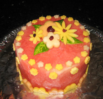 Watermelon Cake with fruit cut with cookie cutters.