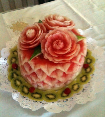 watermelon cake with roses on top