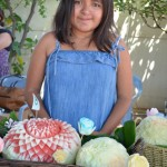 Kimberly Hernandez with her melon carvings