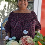 Elisa Hernandez with her melon carvings