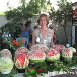 Nita Gill with all of the watermelon carving competition melons.