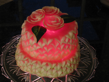 Nita's tiered watermelon cake lit with battery operated lights.