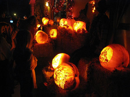 Families in Encinitas enjoying the Halloween pumpkin carvings.