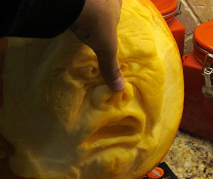 Luis Rodriques carves a pumpkin in the style of Ray Villafane