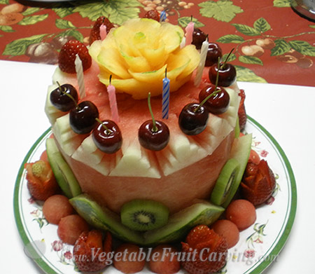 Watermelon cake with cherries on top that Phung made for the elementary school teacher that ordered it after seeing one of her other cakes.