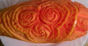 Rose carving techniques used on papaya