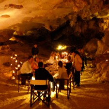 A candle lit dinner in a limestone cave in Vietnam, complete with exotic fruit carvings