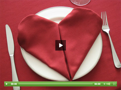napkins folded into a heart shape