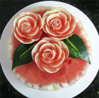 Carved watermelon rose topped cake
