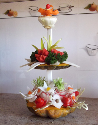 Three tired vegetable and fruit arrangement
