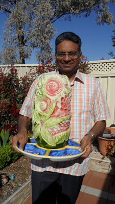 Ali Tahir Butt with carved watermelon cake