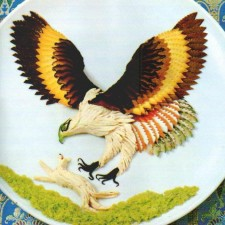 Eagle in mid hunt created from meats and cheeses
