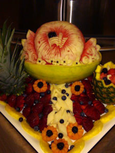 Fruit display with carved watermelon flag by Rose Flores