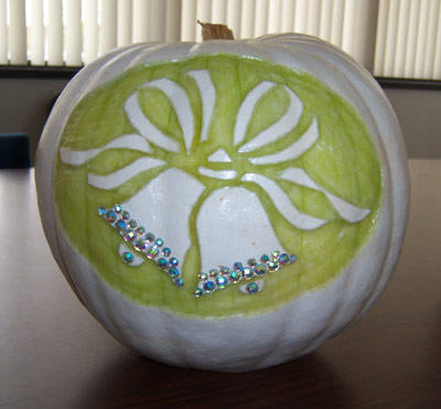white pumpkin carved with wedding bells.