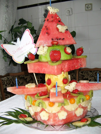 Fruit display that looks like a wacky multi-layer cake.