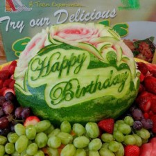 "Mariano Orozco carved this elegant script ""Appy Birthday"" for a pretty watermelon centerpeice."
