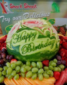 "Mariano Orozco carved this elegant script ""Happy Birthday"" for a pretty watermelon centerpeice."