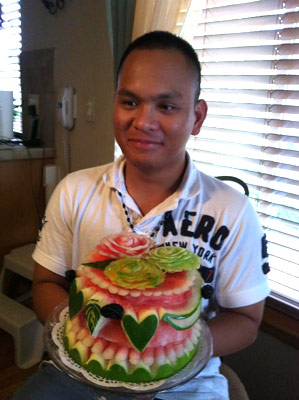 Precy Iraola with another of his watermelon cakes.