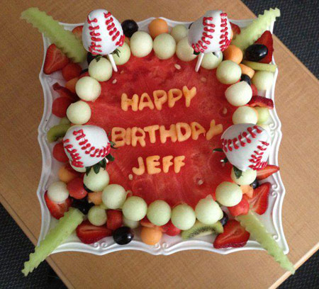 watermelon cake with baseball decorated strawberries