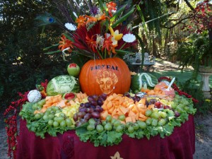 90th birthday party fruit display with carved pumpkin portrait