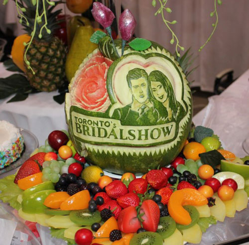 watermelon carving portrait of Brad Smith and Bianca Kamer of THe Bachelor Canada