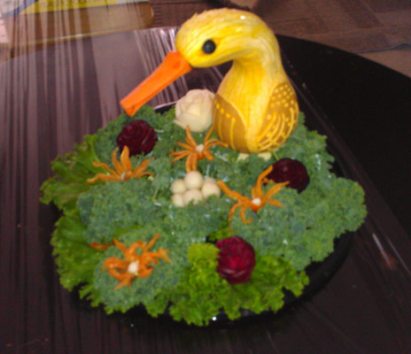 Squash bird with carrot beak.
