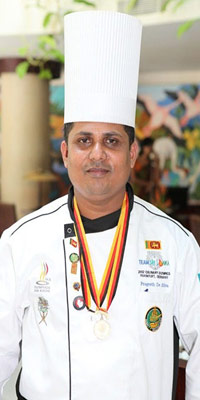 Prageeth proudly wearing his well-earned medals at the Culinary Olympics.