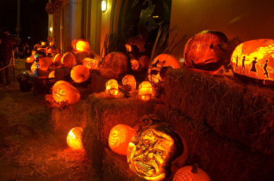 The pumpkin throughout town are lit from inside by electric lights.