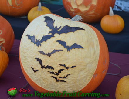 Bats on carved Halloween Pumpkin