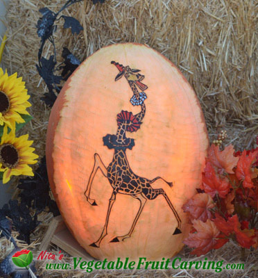 giraffe pumpkin.  0ne of many animal themed pumpkin carvings in this article