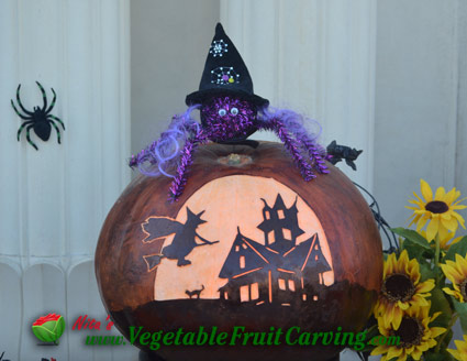 One of my favoret pumpkin carvings Haunted house with witch on broom pumpkin carving