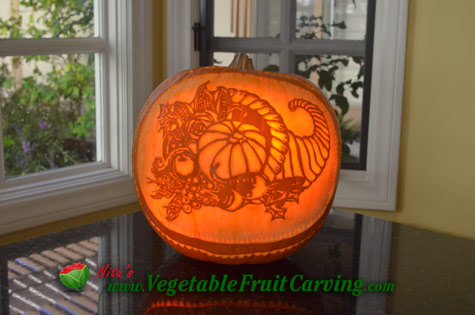 Thanksgiving pumpin carving with cornucopia design
