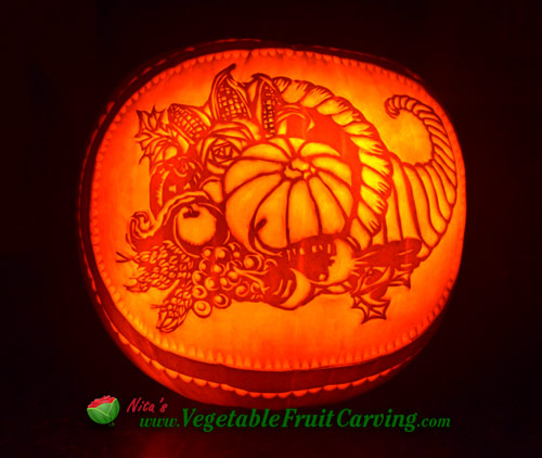 lit Thankgiving pumpkin at night