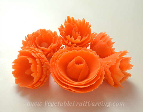 Several carrot flowers made with the carrot curler tool