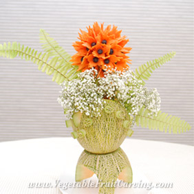 carrot flower bouquet in cantaloupe vase